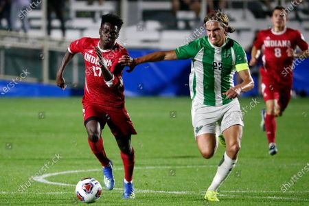 Stock Image of Indiana's Herbert Endeley (17) is challenged by Marshall's Max Schneider (23) during the first half of the NCAA College Cup championship soccer match in Cary, N.C