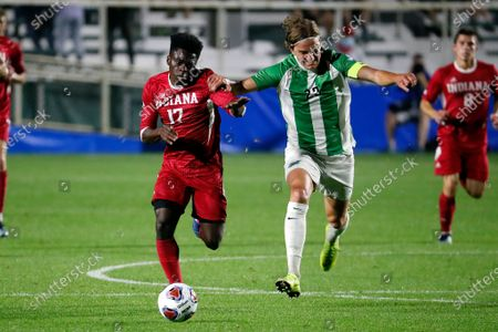 Stock Picture of Indiana's Herbert Endeley (17) is challenged by Marshall's Max Schneider (23) during the first half of the NCAA College Cup championship soccer match in Cary, N.C