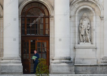 Irish Minister for Public Expenditure and Reform, Michael McGrath, on his way to Government Buildings for a Cabinet meeting. Cabinet meets today to finalise their plans for easing Covid-19 restrictions ahead of Christmas. On Friday, November 27, 2020, in Dublin, Ireland.