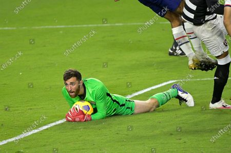 United States goalkeeper Matt Turner makes a save during the second half of an international friendly soccer match against Trinidad and Tobago, in Orlando, Fla