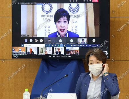 Tokyo Gov. Yuriko Koike speaks on a screen while Tokyo 2020 Olympics organizing committee President Seiko Hashimoto listens to at a meeting of the IOC Coordination Commission for the Tokyo 2020 Olympics in Tokyo on . IOC President Thomas Bach, Hashimoto, Japanese Olympic Minister Tamayo Marukawa and Koike attended a three-day meeting