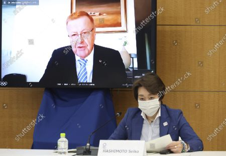 Intrernational Olympic Committee (IOC vice president John Coates speaks on a screen while Tokyo 2020 Olympics organizing committee president Seiko Hashimoto listens at a meeting of the IOC Coordination Commission for the Tokyo 2020 Olympics in Tokyo on . IOC president Thomas Bach, Hashimoto, Japanese Olympic Minister Tamayo Marukawa and Tokyo Gov. Yuriko Koike attended a three-day meeting