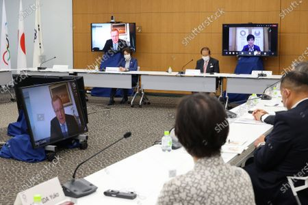 International Olympic Committee (IOC) vice president Johan Coates speaks on a screen while Tokyo 2020 Olympics organizing committee president Seiko Hashimoto (L) and CEO Toshiro Muto (R) listen to at a meeting of the IOC Coordination Commission for the Tokyo 2020 Olympics in Tokyo, Japan, 19 May 2021. IOC president Thomas Bach, Tokyo 2020 organizing committee president Seiko Hashimoto, Japanese Olympic Minister Tamayo Marukawa and Tokyo Governor Yuriko Koike attended a three-day meeting.