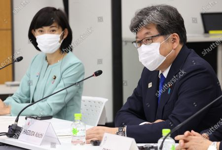 Japanese Education Minister Koichi Hagiuda (R) speaks while Olympic Minister Tamayo Marukawa (L) looks on at a meeting of the IOC Coordination Commission for the Tokyo 2020 Olympics in Tokyo, Japan, 19 May 2021. International Olympic Committee (IOC) president Thomas Bach, Tokyo 2020 organizing committee president Seiko Hashimoto, Japanese Olympic Minister Tamayo Marukawa and Tokyo Governor Yuriko Koike attended a three-day meeting.