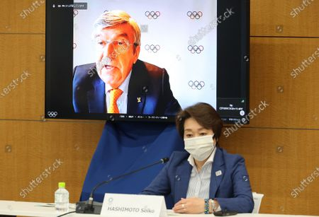 International Olympic Committee (IOC) president Thomas Bach delivers an opening speech on a screen at a meeting of the IOC Coordination Commission for the Tokyo 2020 Olympics as Tokyo 2020 Olympics organizing committee president Seiko Hashimoto listens, in Tokyo, Japan, 19 May 2021. IOC president Thomas Bach, Tokyo 2020 organizing committee president Seiko Hashimoto, Japanese Olympic Minister Tamayo Marukawa and Tokyo Governor Yuriko Koike attended a three-day meeting.