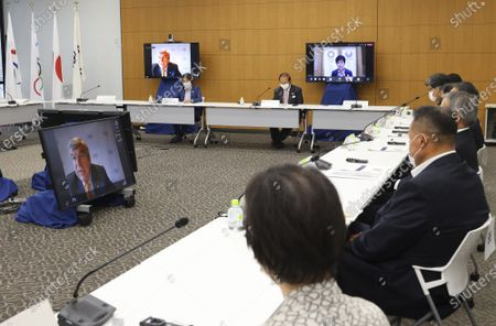 International Olympic Committee (IOC) president Thomas Bach, left, delivers an opening speech on a screen at a meeting of the IOC Coordination Commission for the Tokyo 2020 Olympics in Tokyo on . Bach, Tokyo 2020 organizing committee President Seiko Hashimoto, Japanese Olympic Minister Tamayo Marukawa and Tokyo Gov. Yuriko Koike attended a three-day meeting