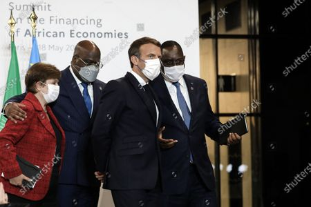 President of the Republic, Emmanuel Macron, the Director General of the International Monetary Fund (IMF), Kristalina Georgieva, President of Senegal, Macky Sall, and the President of the African Union and President of the Democratic Republic of Congo, Felix Tshisekedi at the press conference following the plenary session of the Summit on the financing African economies at Grand Palais Ephemere