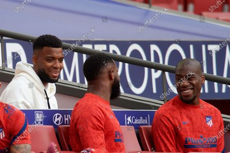 (L-R) Ateltico's French players Thomas Lemar, Moussa Dembele and Geoffrey Kondogbia prior the La Liga Santander match between Atletico de Madrid and C.A. Osasuna at Estadio Wanda Metropolitano on May 16, 2021 in Madrid, Spain. Sporting stadiums around Spain remain under strict restrictions due to the Coronavirus Pandemic as Government social distancing laws prohibit fans inside venues resulting in games being played behind closed doors.
