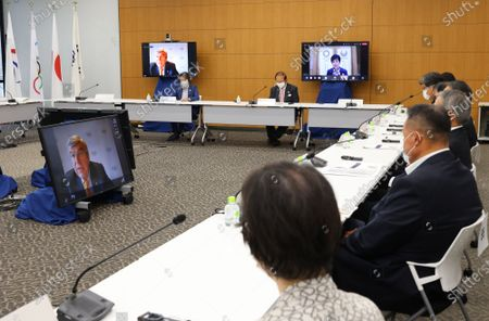 Stock Image of International Olympic Committee (IOC) President Thomas Bach (L) delivers an opening speech on a screen at a meeting of the IOC Coordination Commission for the Tokyo 2020 Olympics in Tokyo, while on May 19, 2021. IOC President Thomas Bach, Tokyo 2020 organizing committee president Seiko Hashimoto, Japanese Olympic Minister Tamayo Marukawa and Tokyo Governor Yuriko Koike attended a three-day meeting.