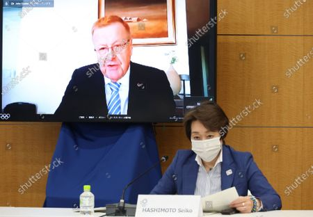 International Olympic Committee (IOC vice president John Coates speaks on a screen while Tokyo 2020 Olympics organizing committee chair Seiko Hashimoto listens to at a meeting of the IOC Coordination Commission for the Tokyo 2020 Olympics in Tokyo on May 19, 2021. IOC President Thomas Bach, Tokyo 2020 organizing committee president Seiko Hashimoto, Japanese Olympic Minister Tamayo Marukawa and Tokyo Governor Yuriko Koike attended a three-day meeting.