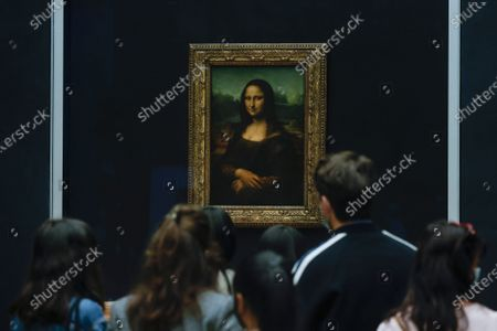 Visitors wearing protective face masks line up to see Leonardo da Vinci's painting La Gioconda (Mona Lisa), at the Louvre Museum in Paris, France, 19 May 2021. France eases some of its coronavirus disease (COVID-19) restrictions starting on 19 May, allowing cultural place, cinema, restaurants and cafes to admit customers outdoors, as pressure on hospitals and intensive care units in the country is diminishing.