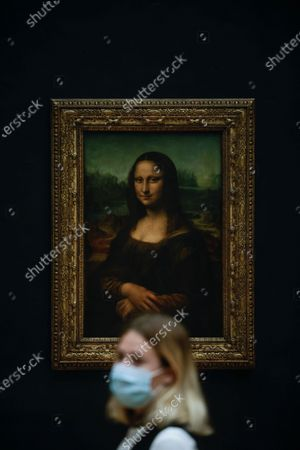 Stock Image of Visitors wearing protective face masks line up to see Leonardo da Vinci's painting La Gioconda (Mona Lisa), at the Louvre Museum in Paris, France, 19 May 2021. France eases some of its coronavirus disease (COVID-19) restrictions starting on 19 May, allowing cultural place, cinema, restaurants and cafes to admit customers outdoors, as pressure on hospitals and intensive care units in the country is diminishing.
