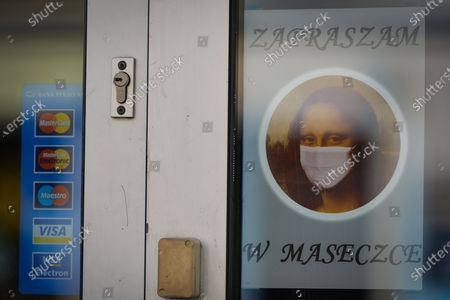 A sticker with an image of Mona Lisapainted by Leonardo da Vinci 'Feel free to wear a mask' at the entrace to a business in krakow. On September 13, 2020, in Krakow, Poland.