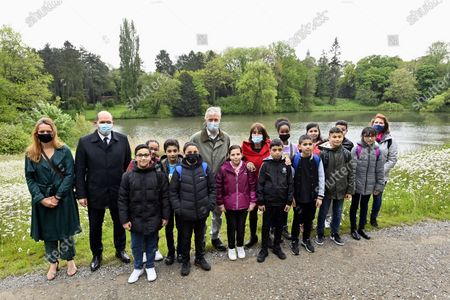 Stock Photo of Brussels City mayor Philippe Close (2L), King Philippe of Belgium and kids are pictured during the first educational visit on the biodiversity in the domain of the Royal castle in Laken/Laeken  for pupils of Brussels schools, Brussels, Belgium, 19 May 2021.