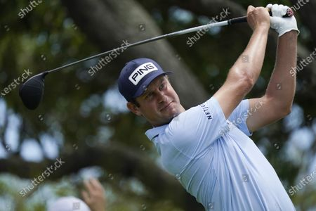 Harris English watches his tee shot on the seventh tee during a practice round at the PGA Championship golf tournament on the Ocean Course, in Kiawah Island, S.C