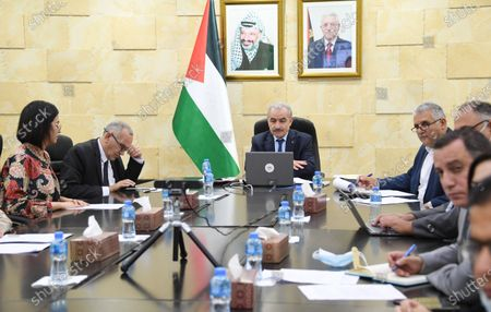 Palestinian Prime Minister Mohammed Ishtayeh meets with Facebook Head of Global Affairs and Communications Nick Clegg via video conference, in the West Bank city of Ramallah. on May 19, 2021. Photo by Prime Minister Office
