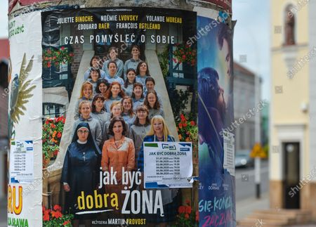 """A view of a poster advertising Martin Provost's new movie """"How To Be A Good Wife' seen in Lezajsk Market Square.On August 3rd, 2020, in Lezajsk, Subcarpathian Voivodeship, Poland."""
