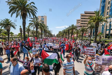 Stock Photo of General view of the pro Palestine protest in Tunis. Tunisian Genral Labour union (UGTT) called for protest to support palestinians after the latest israeli attacks on Gza strip and Sheikh JArrah neighbourhood.