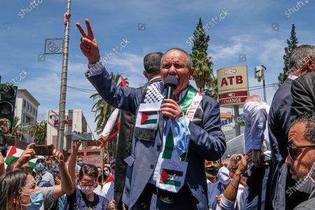 Stock Picture of Noureddine Taboubi (C)the general secretary of the UGTT speaks in front the protesters pro Palestine protest. Tunisian Genral Labour union (UGTT) called for protest to support palestinians after the latest israeli attacks on Gza strip and Sheikh JArrah neighbourhood.