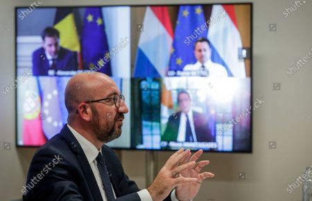 European Council President Charles Michel speaks with Belgian Prime Minister Alexander De Croo, Luxembourg's Prime Minister Xavier Bettel, Portugal's Prime Minister Antonio Costa and Cypriot President Nicos Anastasiades during a meeting via video link at the European Council building in Brussels, . European Council President Charles Michel is meeting with EU leaders via video link to prepare for an upcoming EU summit which begins on Monday