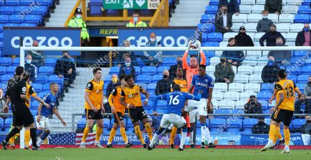 Wolverhampton Wanderers' goalkeeper John Ruddy makes a save during the English Premier League soccer match between Everton and Wolverhampton Wanderers at Goodison Park stadium in Liverpool, England