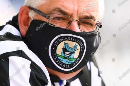 Fan of Newcastle wears a face mask to protect against the coronavirus, prior to the English Premier League soccer match between Newcastle United and Sheffield United at St. James' Park in Newcastle, England