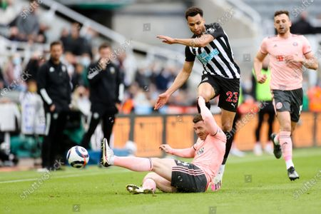 Newcastle's Jacob Murphy challenges with Sheffield United's John Fleck, bottom, during the English Premier League soccer match between Newcastle United and Sheffield United at St. James' Park in Newcastle, England