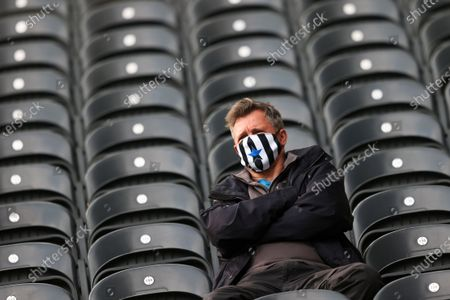 Fan of Newcastle wears a face mask to protect against the coronavirus prior to the English Premier League soccer match between Newcastle United and Sheffield United at St. James' Park in Newcastle, England