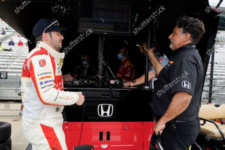 Marco Andretti, left, talks with Michael Andretti during practice for the Indianapolis 500 auto race at Indianapolis Motor Speedway, in Indianapolis