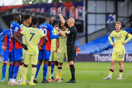 Crystal Palace #20 forward Christian Benteke shown yellow card with Arsenal midfielder Mohamed Elneny (25) during the Premier League match between Crystal Palace and Arsenal at Selhurst Park, London