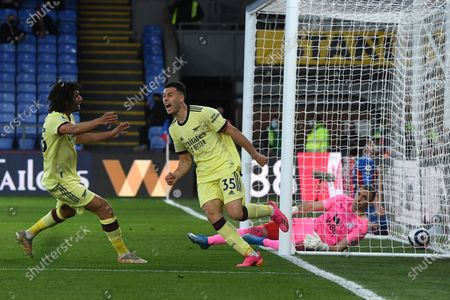 Arsenal's Gabriel Martinelli, right, celebrates after scoring his side's second goal with Arsenal's Mohamed Elneny during the English Premier League soccer match between Crystal Palace and Arsenal, at Selhurst Park in London, England