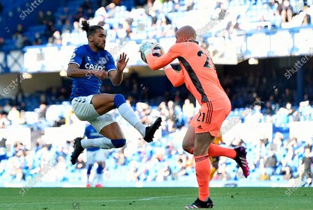 Stock Photo of Everton's Dominic Calvert-Lewin (L) in action against Wolverhampton Wanderers' goalkeeper John Ruddy (R) during the English Premier League soccer match between Everton FC and Wolverhampton Wanderers in Liverpool, Britain, 19 May 2021.