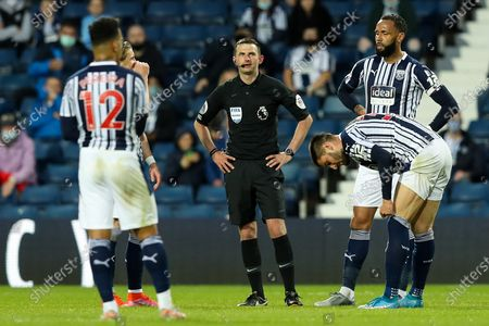 Referee Michael Oliver waits for the VAR to confirm a goal by Tomas Soucek of West Ham United