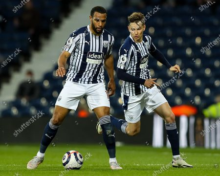 Matt Phillips of West Bromwich Albion controls the ball, flanked by Conor Townsend of West Bromwich Albion
