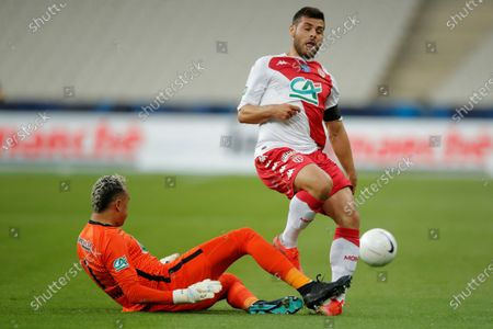 PSG's goalkeeper Keylor Navas, left, blocks Monaco's Kevin Volland during the French Cup final soccer match between Paris Saint Germain and Monaco at the Stade de France stadium, in Saint Denis, north of Paris