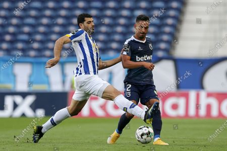 Stock Image of FC Porto's Mehdi Taremi (L) in action against Belenenses SAD's Diogo Calila during their Portuguese First League soccer match at Dragao stadium, Porto, Portugal, 19 May 2021.