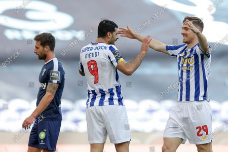 FC Porto players Mehdi Taremi (C) and Toni Martínez (R) celebrate after scoring a goal against Belenenses SAD during their Portuguese First League soccer match at Dragao stadium, Porto, Portugal, 19 May 2021.