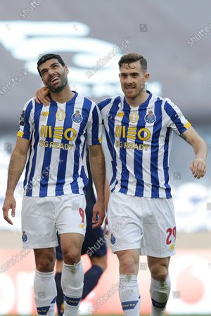 Stock Picture of FC Porto players Mehdi Taremi (L) and Toni Martínez celebrate after scoring a goal against Belenenses SAD during their Portuguese First League soccer match at Dragao stadium, Porto, Portugal, 19 May 2021.