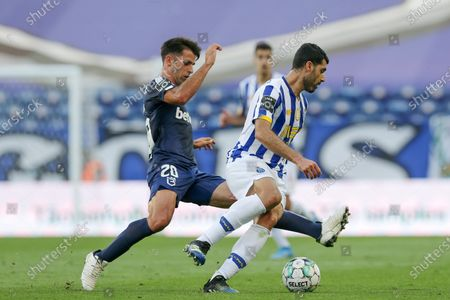 FC Porto's Mehdi Taremi (R) in action against Belenenses SAD's Afonso Taira during their Portuguese First League soccer match at Dragao stadium, Porto, Portugal, 19 May 2021.