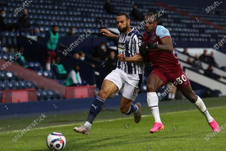 West Bromwich Albion's Matt Phillips, left, is challenged by West Bromwich Albion's Ainsley Maitland-Niles during the English Premier League soccer match between West Bromwich Albion and West Ham at the The Hawthorns Stadium in West Bromwich, England