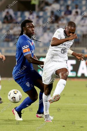 Stock Photo of Al-Hilal's player Bafetimbi Gomis (L) in action against Al-Ahli's Motaz Hawsawi (R) during the Saudi Professional League soccer match between Al-Hilal and Al-Ahli at Prince Faisal Bin Fahd Stadium, Riyadh, Saudi Arabia, 19 May 2021.