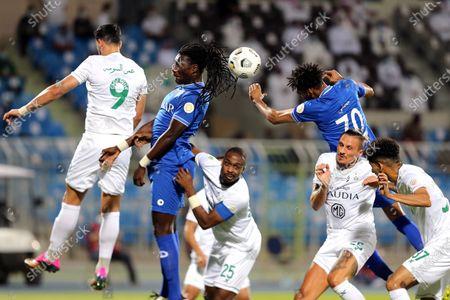 Stock Picture of Al-Hilal's players Bafetimbi Gomis (2-L) and Mohammed Jahfali (2-R, up) in action against Al-Ahli's Omar Al-Somah (L), Motaz Hawsawi (C), Ljubomir Fejsa (2-R, down) and Abdulbaset Al-Hindi (R) during the Saudi Professional League soccer match between Al-Hilal and Al-Ahli at Prince Faisal Bin Fahd Stadium, Riyadh, Saudi Arabia, 19 May 2021.