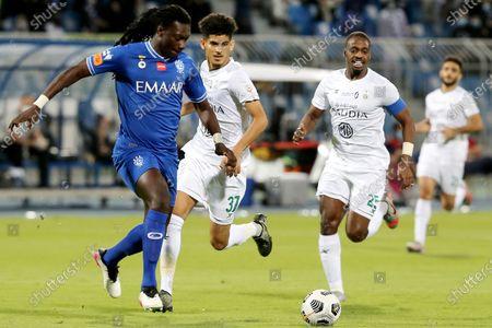 Stock Image of Al-Hilal's player Bafetimbi Gomis (L) in action against Al-Ahli's Motaz Hawsawi (R) and Abdulbaset Al-Hindi (C) during the Saudi Professional League soccer match between Al-Hilal and Al-Ahli at Prince Faisal Bin Fahd Stadium, Riyadh, Saudi Arabia, 19 May 2021.