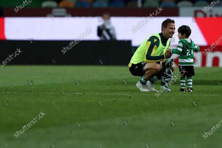 Joao Pereira of Sporting CP with his son at the end of the Portuguese League football match between Sporting CP and CS Maritimo at Jose Alvalade stadium in Lisbon, Portugal on May 19, 2021.