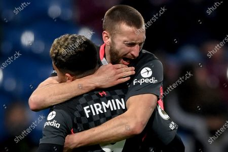 Liverpool's Nathaniel Phillips (R) celebrates with his teammate Roberto Firmino (L) after scoring the 2-0 lead during the English Premier League soccer match between Burnley FC and Liverpool FC in Burnley, Britain, 19 May 2021.