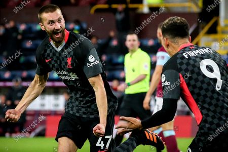 Liverpool's Nathaniel Phillips (L) celebrates with his teammate Roberto Firmino (R) after scoring the 2-0 lead during the English Premier League soccer match between Burnley FC and Liverpool FC in Burnley, Britain, 19 May 2021.