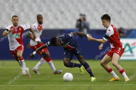 AS Monaco's Aleksandr Golovin (R) and Paris Saint Germain's Idrissa Gueye (C) in action during the Coupe de France final soccer match between AS Monaco and Paris Saint Germain, in Saint-Denis, France, 19 May 2021.