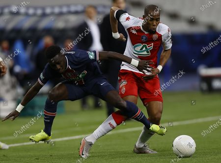 AS Monaco's Djibril Sidibe (R) and Paris Saint Germain's Idrissa Gueye in action during the Coupe de France final soccer match between AS Monaco and Paris Saint Germain, in Saint-Denis, France, 19 May 2021.