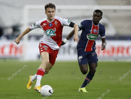 AS Monaco's Aleksandr Golovin (L) and Paris Saint Germain's Idrissa Gueye in action during the Coupe de France final soccer match between AS Monaco and Paris Saint Germain, in Saint-Denis, France, 19 May 2021.