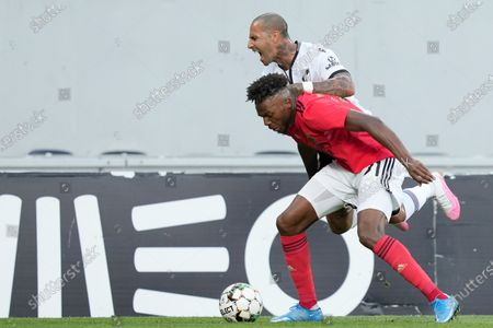 Vitoria de Guimaraes player Ricardo Quaresma (up) in action against Benfica player Nuno Tavares during their Portuguese First League soccer match held at D. Afonso Henriques Stadium, Guimaraes, Portugal, 19 May 2021.